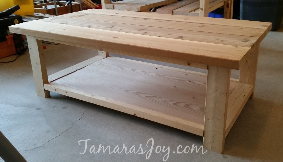 I built my own modern diy coffee table tamaras joy here is where i am figuring out the order of the table top boards these were our left over fence boards geotapseo Gallery